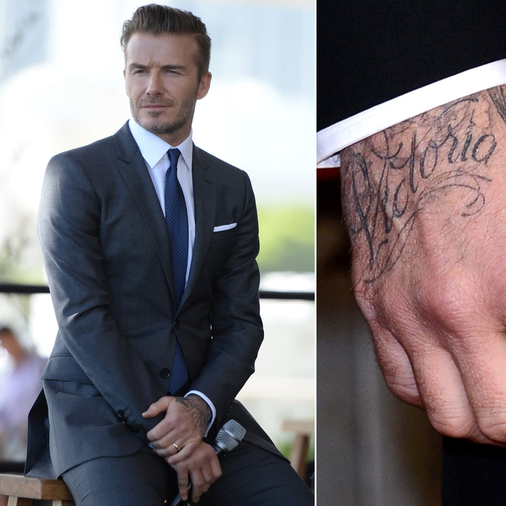"""You don't need to put your glasses on to spot the big """"Victoria"""" tattoo on David Beckham's right hand."""