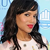Kerry Washington attended the Teen Choice Awards in a playfully sparkling dress. She matched the look with bright red lips and a shimmering purple shadow on her lids.
