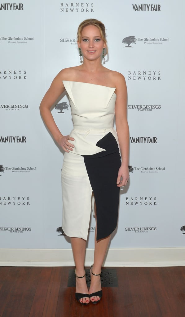 Jennifer Lawrence slipped into a sharp, chic black-and-white Roland Mouret strapless at Vanity Fair and the Weinstein Company's party for Silver Linings Playbook. She completed her look with dramatic drop earrings and gold-trimmed ankle-strap evening sandals.