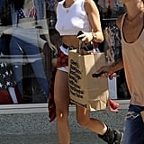 Miley Cyrus had an American Apparel bag in her hands as she left the store with friends.
