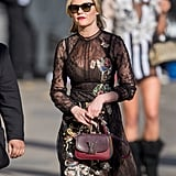 Kirsten Paired Her Black Embroidered Dress With a Colorful Purse