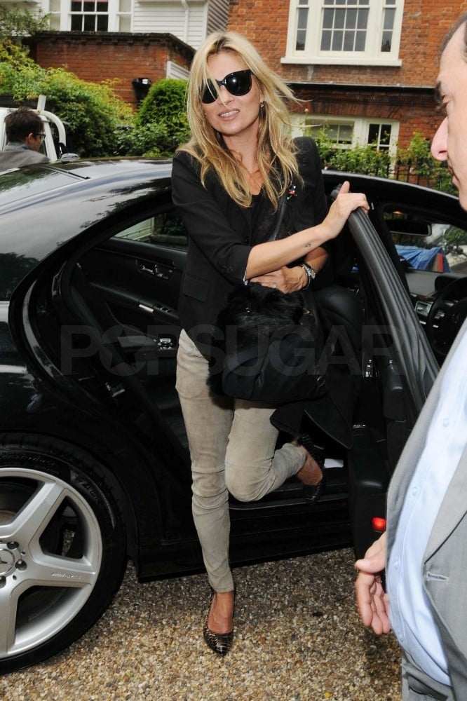 Kate Moss flashed a smile as she left her London home today in a blazer and skinny suede pants. The supermodel is back from a quick jaunt to Paris, where she toasted her collaboration with photographer Terry Richardson and retailer Mango with fiancé Jamie Hince. Kate and The Kills front man, who have been dating off and on since 2007, are expected to tie the knot this Summer. Nothing was revealed about their plans in Kate's new interview with The Telegraph of London, though she did share her enthusiasm for the recent royal wedding and her newfound hobby of making jam. The nuptials would be the latest milestone in what's already been a big year for Kate. She currently has the rare honor of gracing two separate Vogue covers at once and was ranked as one of the world's highest-paid models by Forbes with a reported income of $14 million in 2010.