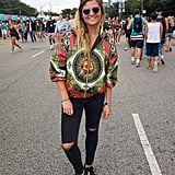 Trying to show a little skin at Lollapalooza but worried you might get cold? Take a cue from this festivalgoer, who zipped an eye-catching bomber over her black bikini top.
