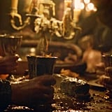 Guests pounding on the table to get everyone's attention at the Red Wedding