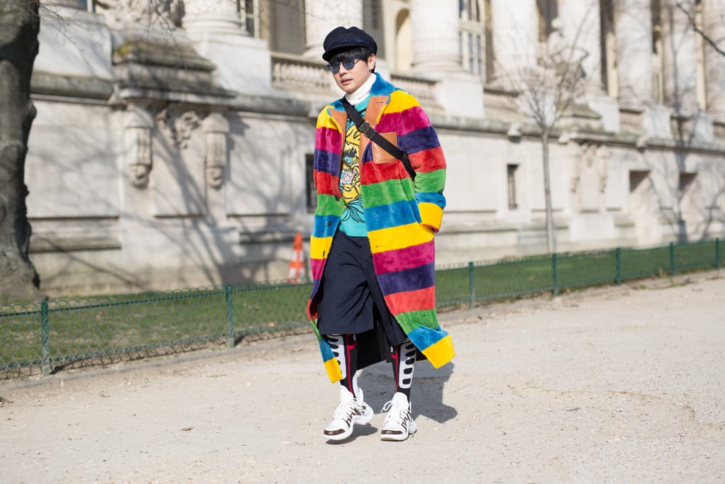 eabdc4492cd A Fashion Week guest rocked a long rainbow coat with dad sneakers ...