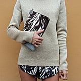 Now this is coordination. This styler outfitted her look with a zebra-print clutch and matching bottoms. Source: IMAXtree