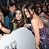 Lucy Hale leaned in for a picture with a fan.