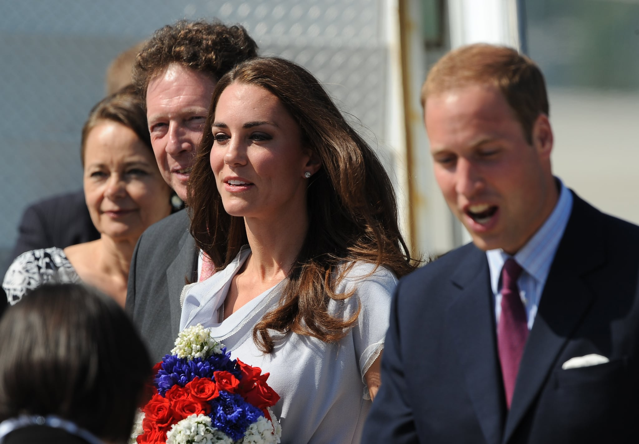Kate Middleton and Prince William were welcomed by dignitaries.