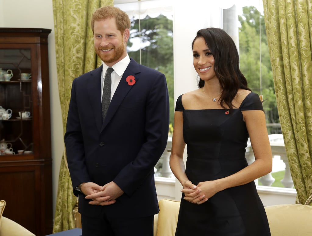 Meghan wore earrings from Birks and a necklace from Simon James, along with a small poppy pin.
