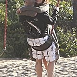 Jennifer Lopez and Casper Smart played on a swing.