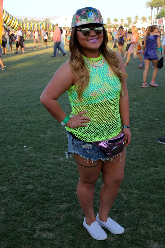 Flashes of neon and a metallic fanny pack were played up by a pastel purple lip.