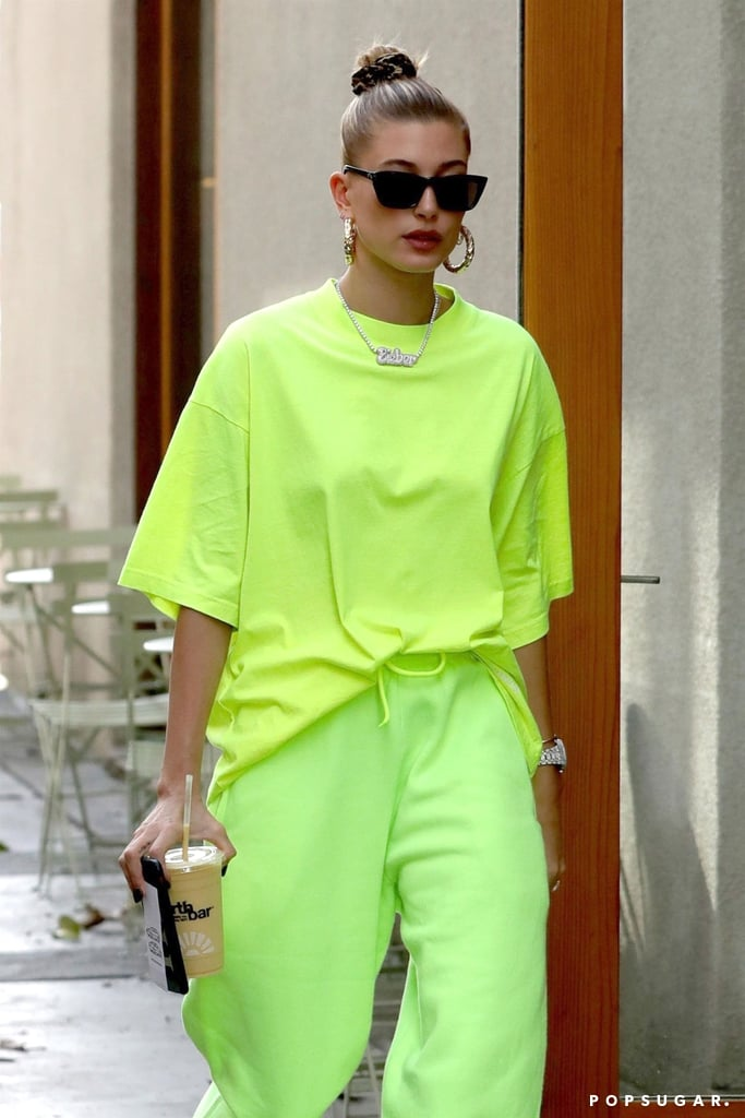 Hailey Baldwin recently went incognito as she arrived at a hair salon in Los Angeles. Just kidding — she was in head-to-toe highlighter green. The model wore sweatpants and an oversize t-shirt in the same electric shade and accessorized the outfit with chunky sneakers, gold hoop earrings, and sleek sunglasses. As I'm sure you already noticed, Hailey was also wearing her new Bieber nameplate necklace, which is blindingly blingy. That's all in addition to her stunning oval-shaped engagement ring, by the way. Ahead, see pictures from her latest outing and shop similar neon t-shirts and sweatpants.      Related:                                                                                                           Hailey Is So Bieber Right Now, She's Even Starting to Dress Like Him