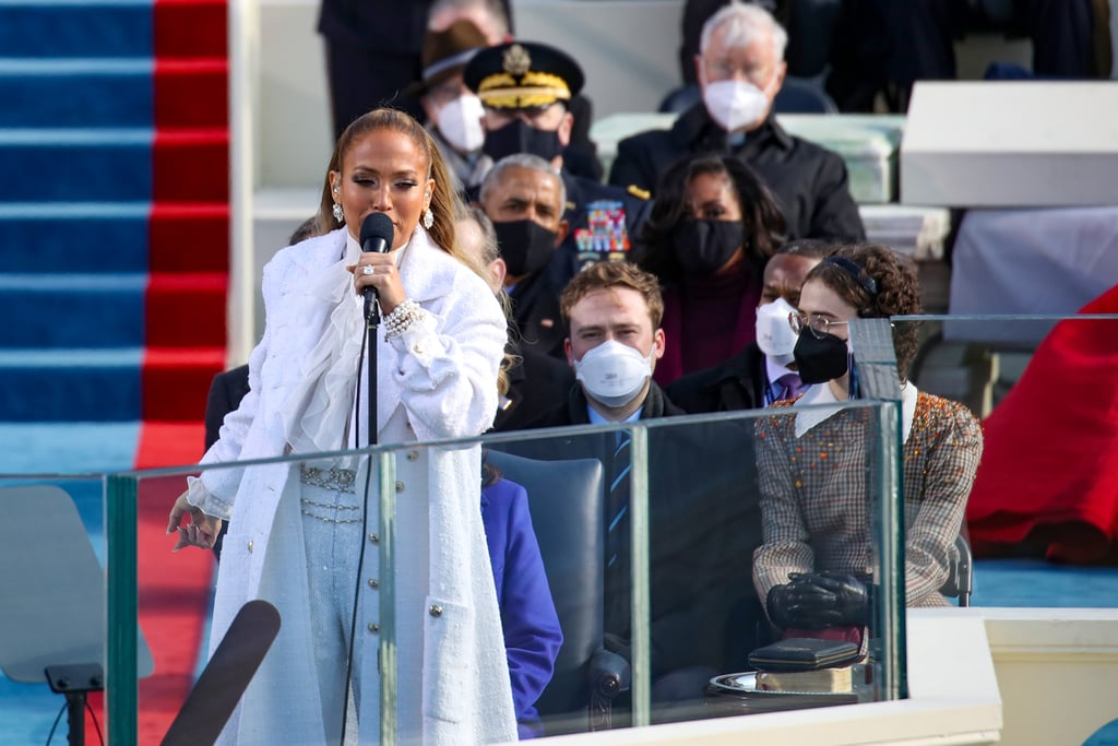 Jennifer Lopez loves a monochromatic moment. After traveling to Washington DC in an all-gray Alberta Ferretti outfit, the singer wore head-to-toe white to perform during Joe Biden's presidential inauguration on Jan. 20. The color white is often associated with the women's suffrage movement, and fellow inaugural performer Lady Gaga also wore all-white when she arrived at Capitol Hill the day before the political ceremony.  Jennifer's glamorous winter whites consisted of a tweed coat, ruffled blouse, and — the real showstopper — sequin wide-leg trousers, all by Chanel. Her gold chain belt, statement earrings, and stacked bracelets were also Chanel, while her platform heels were Jimmy Choo. Browse photos of the sleek, quintessentially J Lo look ahead.       Related:                                                                                                           Kamala Harris Supports a Black LGBTQ+ Designer With Her Purple Inauguration Coat