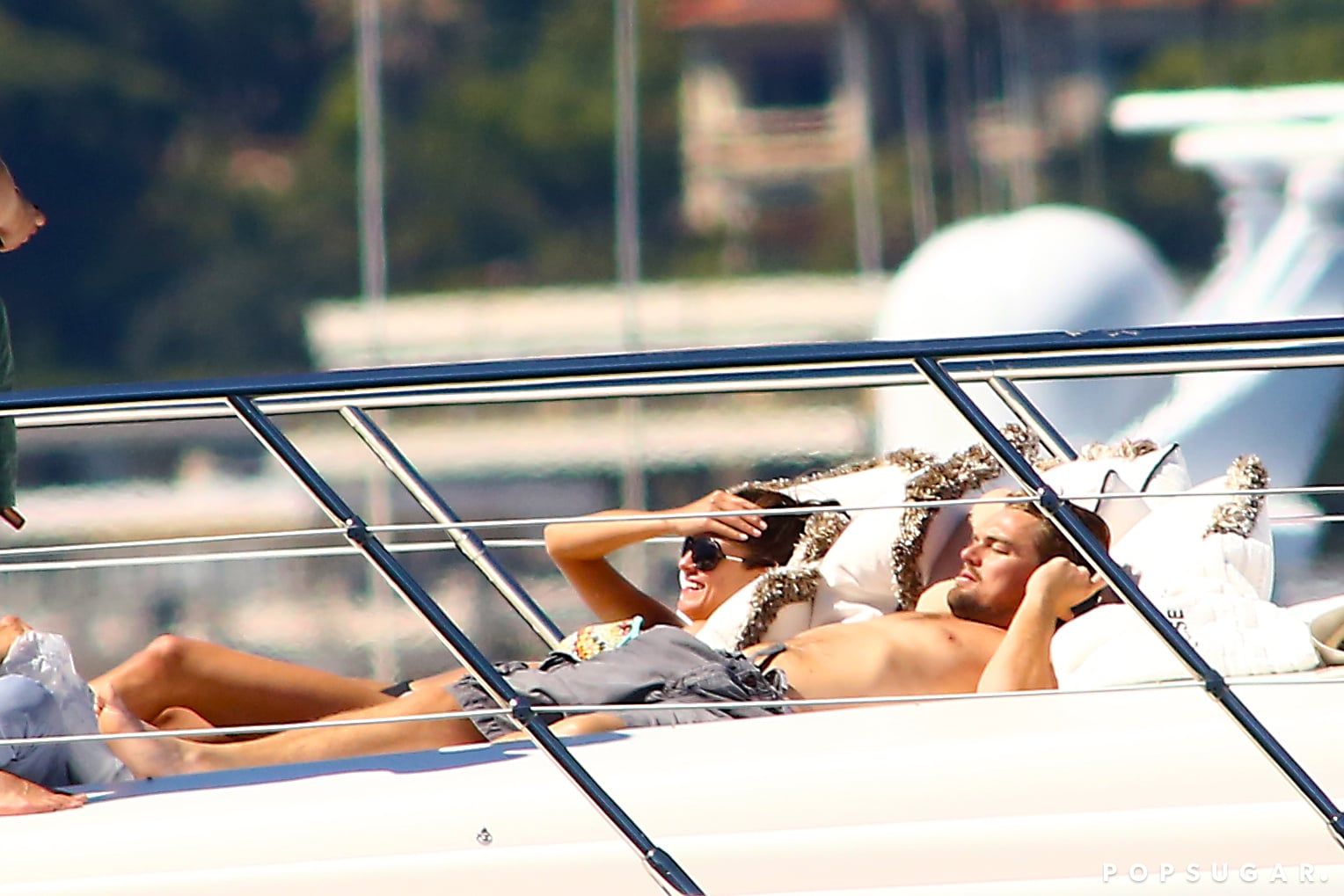 Leo Lounges Shirtless on a Yacht Surrounded By Ladies