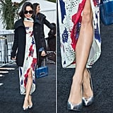 Vanessa Hudgens exited the New York Fashion Week premises looking stylish in a printed wrap dress and a pair of shiny silver platform pumps.