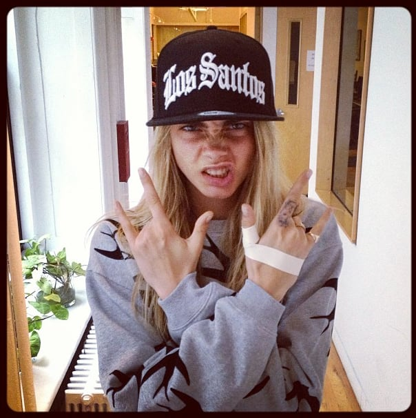 Cara Delevingne struck a fierce pose in a McQ by Alexander McQueen sweater and a Los Santos cap.  Shop it: McQ by Alexander McQueen Swallow Sweatshirt ($345).  Source: Instagram user caradelevingne
