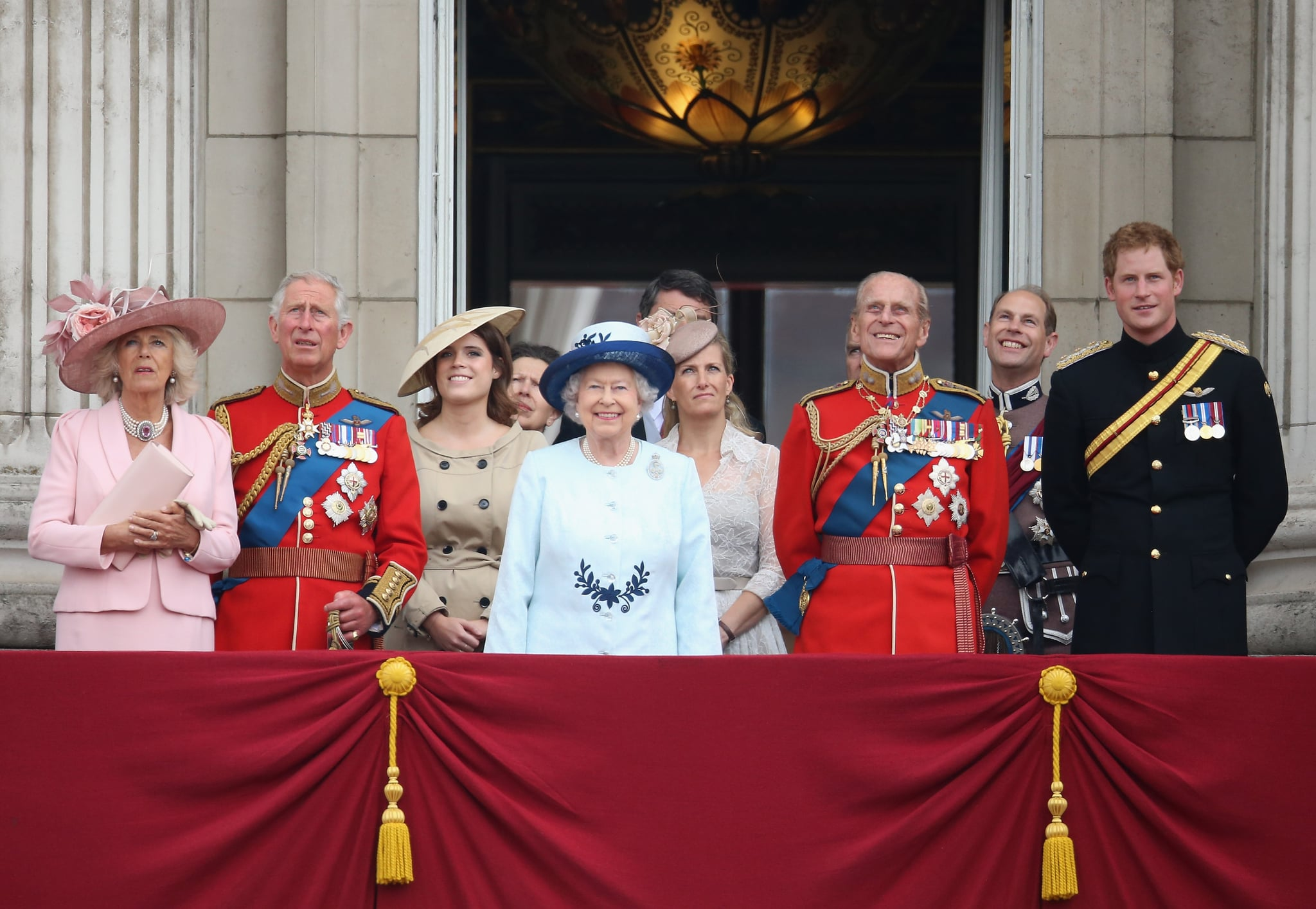 LONDON, ENGLAND - JUNE 14:  (L-R) Camilla, Duchess of Cornwall, Prince Charles, Prince of Wales, Princess Eugenie, Queen Elizabeth II, Sophie, Countess of Wessex, Prince Philip, Duke of Edinburgh, Prince Edward, Earl of Wessex and Prince Harry look on from the balcony during Trooping the Colour - Queen Elizabeth II's Birthday Parade, at The Royal Horseguards on June 14, 2014 in London, England.  (Photo by Chris Jackson/Getty Images)