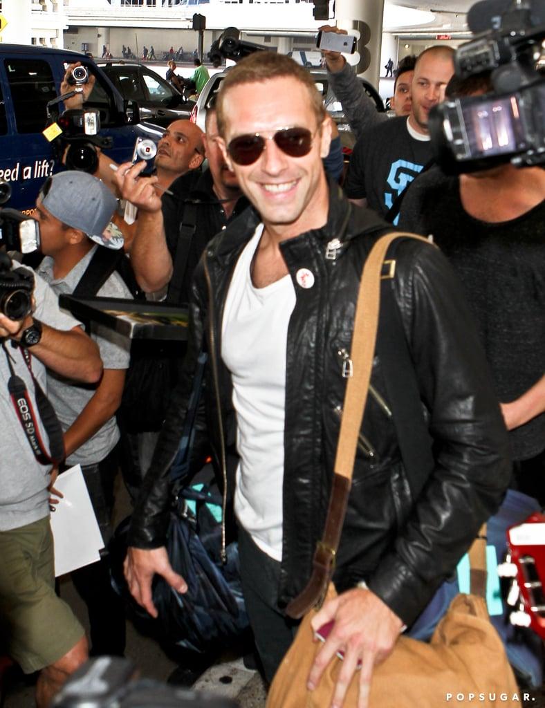 Chris Martin smiled while walking through LAX on Thursday.