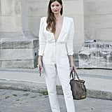 Feature shoulders makes a white jumpsuit totally suitable for Summer work meetings.
