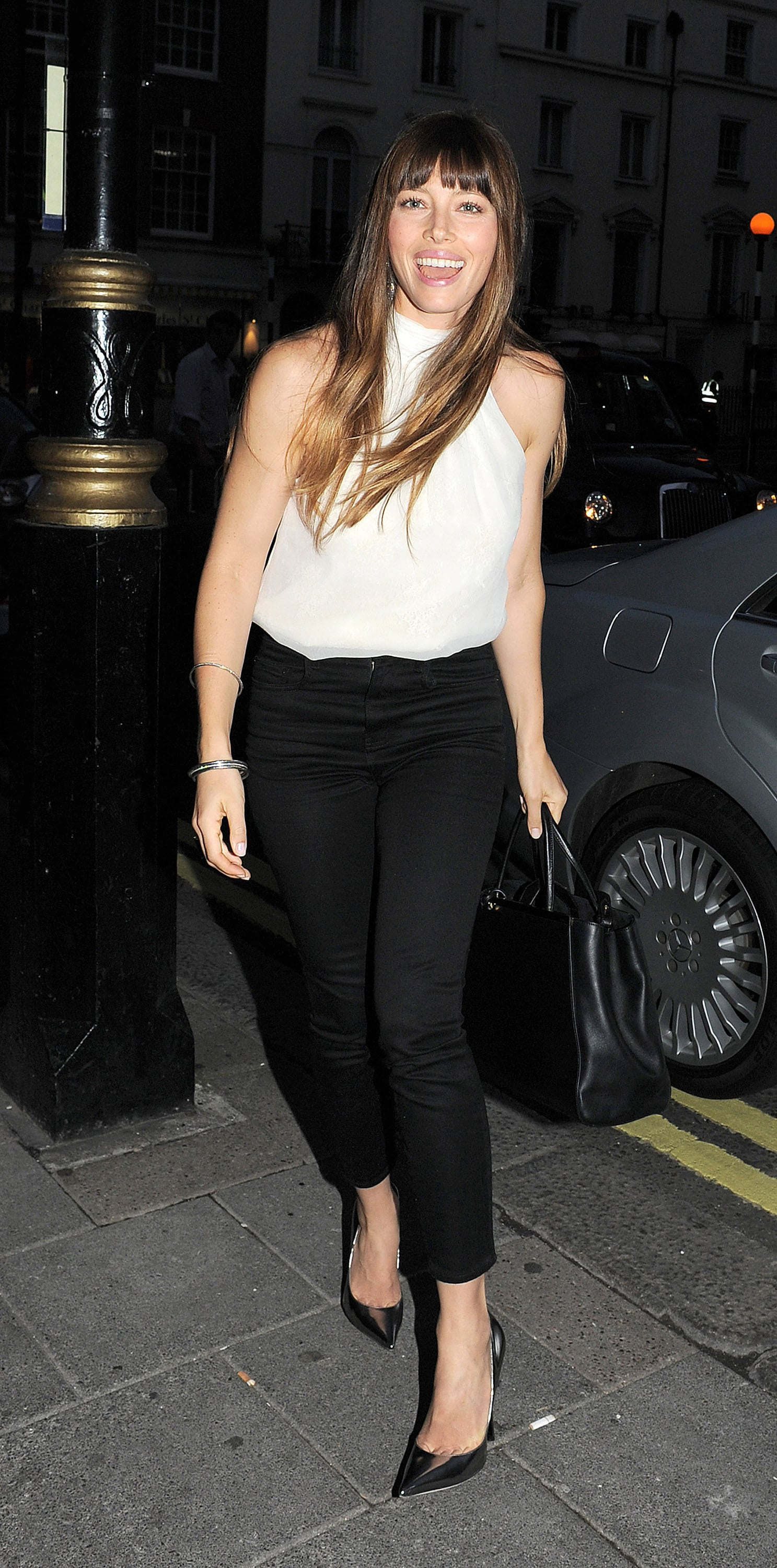 Jessica Biel happily headed into a private screening of Total Recall in London.