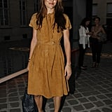 Charlotte played it ladylike but casual in a suede fit-and-flare dress and wood-heeled sandals in Paris in 2011.