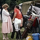 Diana stepped out in the heat of June to cheer on Prince Charles during a polo match clad in a loose-fitting pink pastel dress, tights, simple white flats, and a matching cardigan. She polished off her look with a delicate choker necklace — funny how things come back in style after a decade or two.