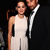 Marion Cotillard and Matthias Schoenaerts posed together for a photo.