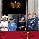 William turned to a smiley Meghan on the balcony of Buckingham Palace in July.