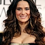 Salma Hayek wore her hair long and curly.