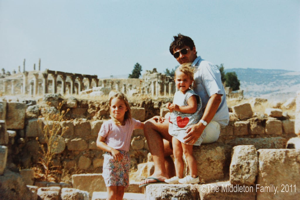Aww! Kate (left) and Pippa posed with their dad, Michael Middleton, when they lived in Amman, Jordan, in 1986.