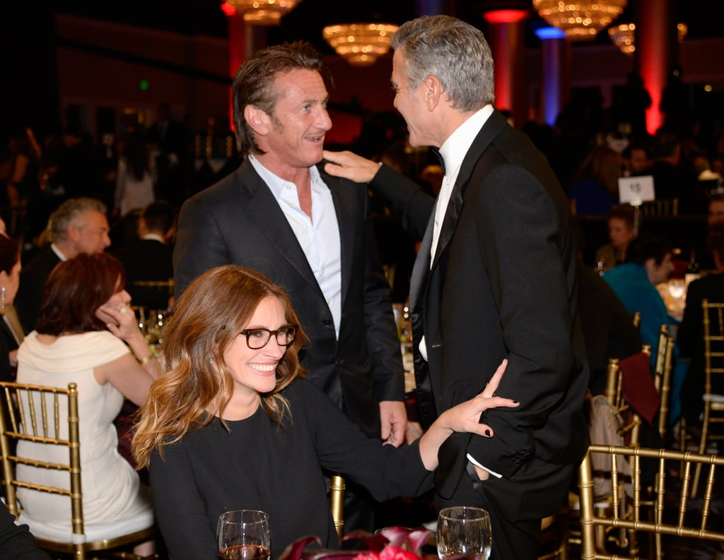 Julia Roberts, Sean Penn, and George Clooney chatted at their table.