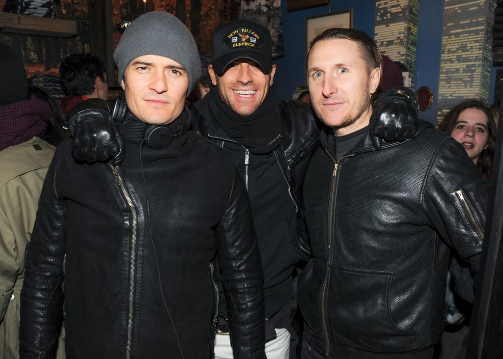 """Justin Theroux took a break from celebrating fiancée Jennifer Aniston's birthday on Tuesday to play bad boy with Orlando Bloom and friend Scott Campbell. The trio visited the Deth Killers popup shop in NYC, where they popped fake wheelies on a motorcycle that was set up outside the shop and browsed clothing from the motorcycle-focused brand. Scott, who, like Justin, left his significant other, Lake Bell, at home for the night out, played on the hog with Orlando, while Justin mingled with friends inside the shop. While most of us think of Orlando as the sweet-faced actor who stole our hearts in movies like Lord of the Rings, he is actually an avid rider, much like Justin.  Justin is currently in NYC to continue filming for his HBO show, The Leftovers. While Jennifer skipped the motorcycle bash, she did pop up in Ranchos Palos Verdes, CA, on Monday to interview feminist icon Gloria Steinem for The Makers Conference. During the pair's public chat, Jennifer complained about how women are portrayed in the media, saying, """"I know you've come up against this, and I certainly have too — where being a woman and our value and our worth is basically associated with our marital status or whether or not we have procreated."""""""