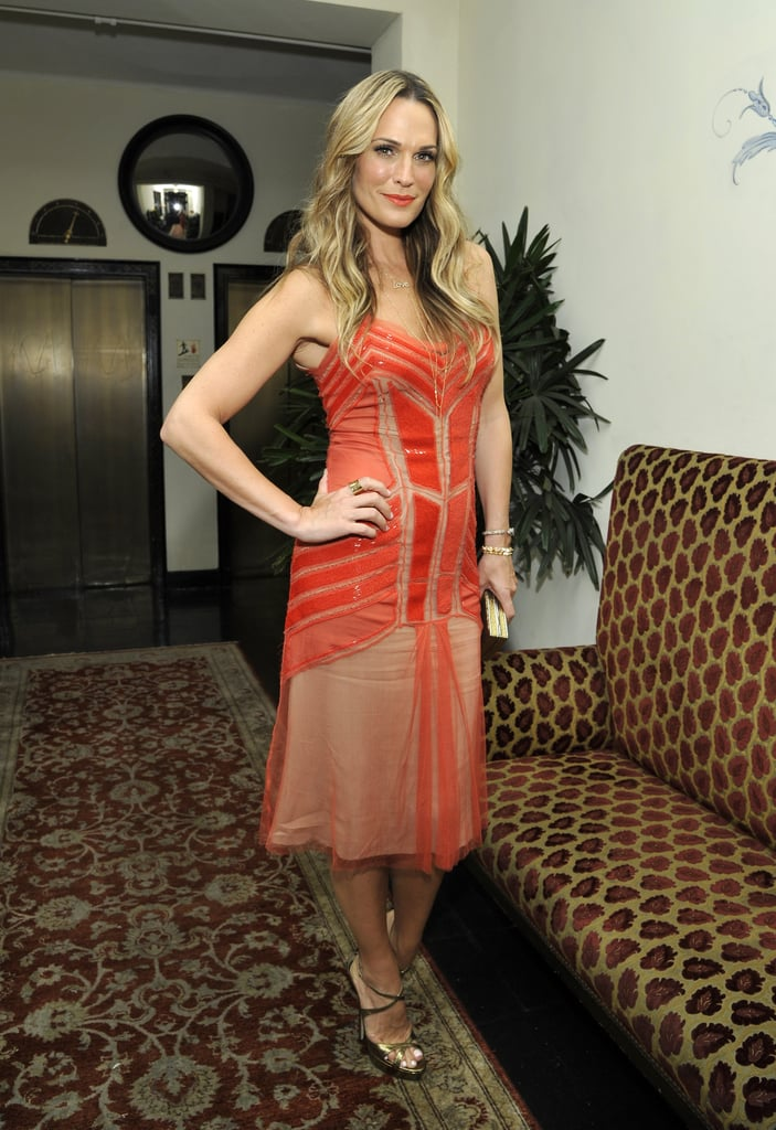 Molly Sims brightened up the bash in a red dress.