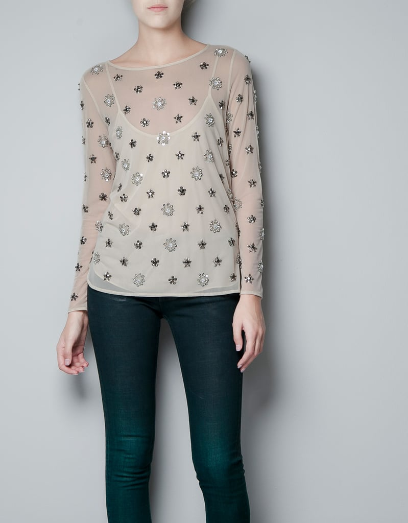 A pair of skinny leather trousers would certainly add edge to this feminine blouse.