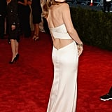 Olivia Wilde's two-piece Calvin Klein look highlighted her tiny waist and drew attention to her toned midriff.