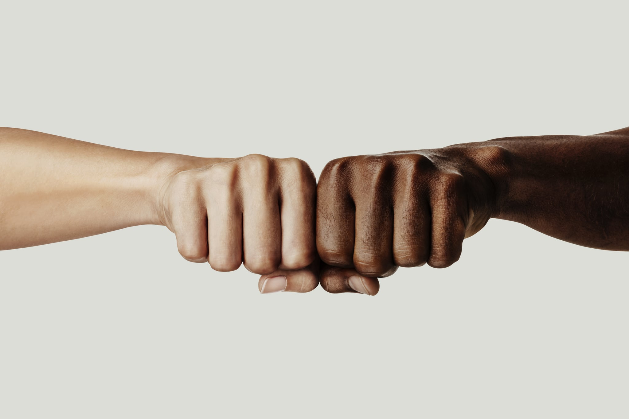 Black Lives Matter, two interracial fists, Punch