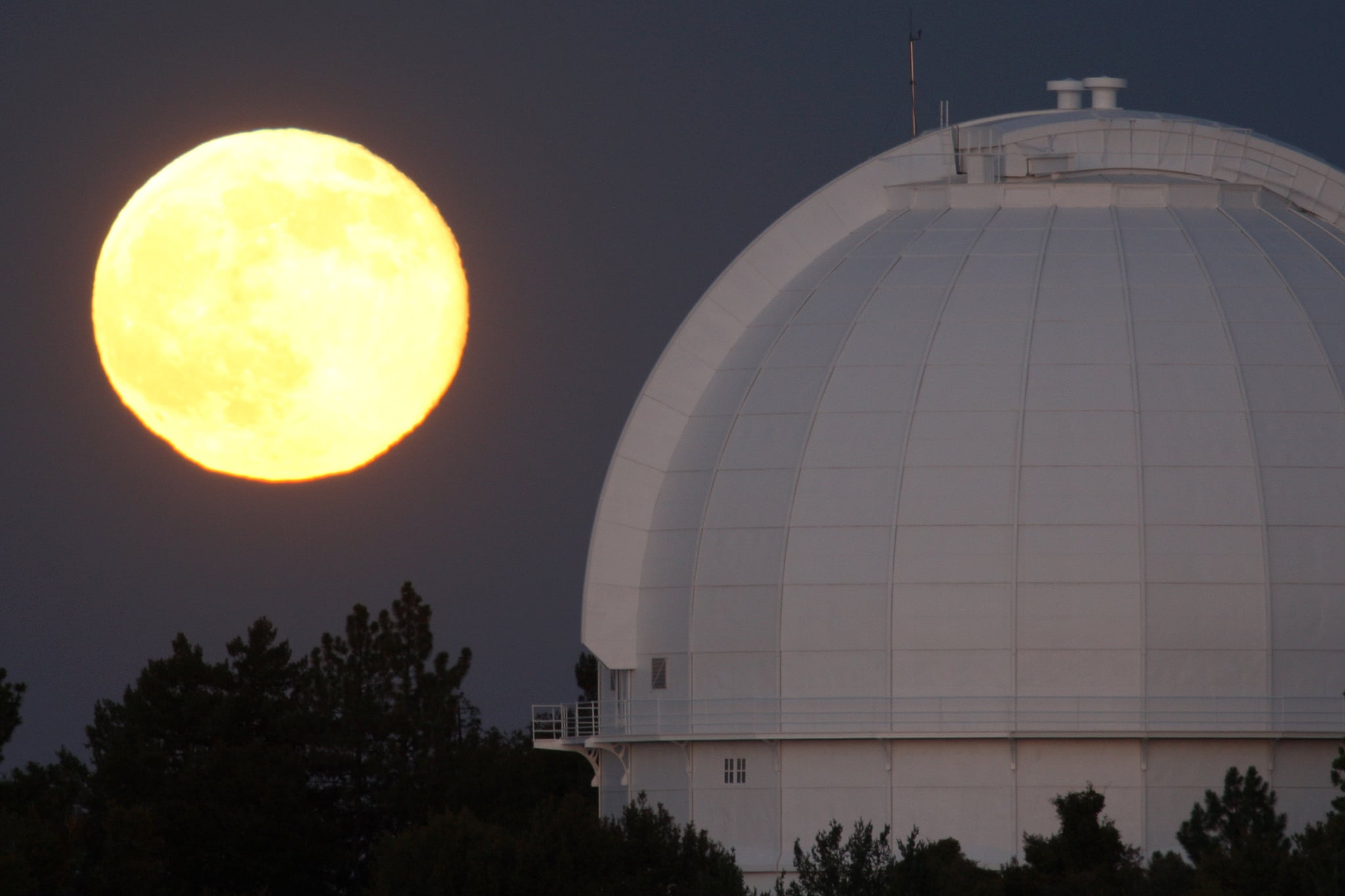 The supermoon sizes itself up next to the Mount Wilson Observatory in Los Angeles on July 12.