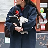 Katie Holmes carried a stuffed toy through New York City.