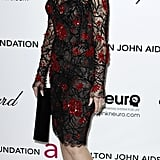 Gwen Stefani showed off her eclectic style in a Zuhair Murad Couture sheer black cocktail frock with intricate beading and red floral-appliqué.
