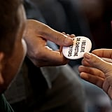"""Yale University Law School students pass a button that reads, """"I believe Dr. Christine Blasey Ford."""""""