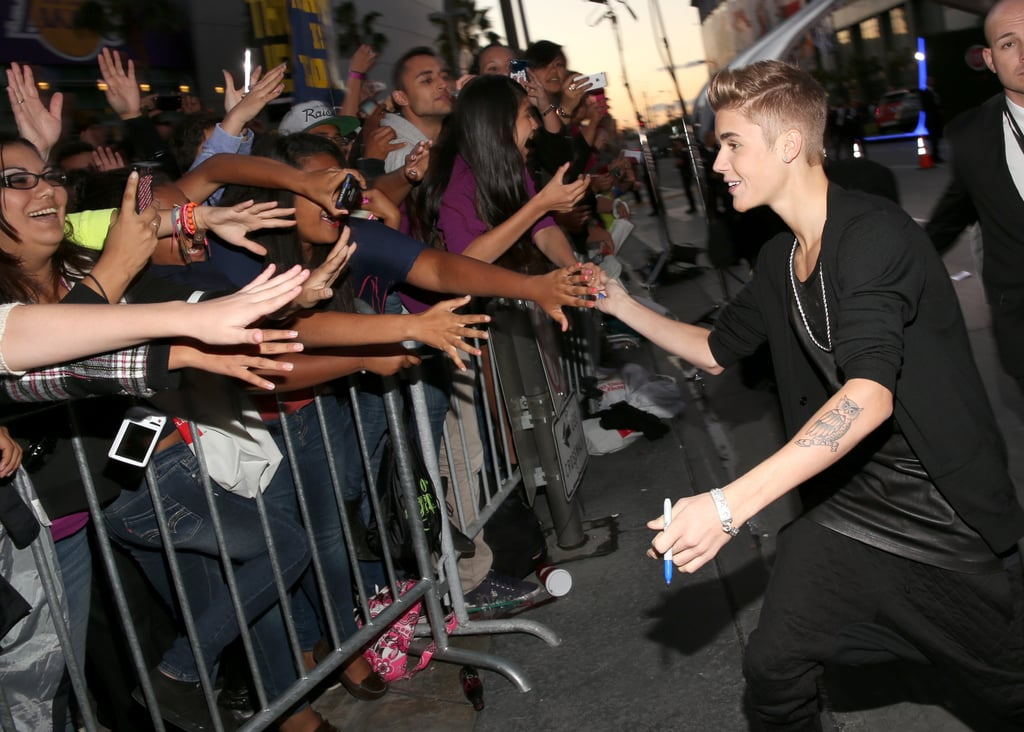 Justin Bieber gave fans high fives as he arrived at the American Music Awards.