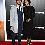 We're not sure what we're loving more here: Matthew's blue Dolce & Gabbana suit paired with that gray Salvatore Ferragamo overcoat or Camila's glam Marchesa dress.