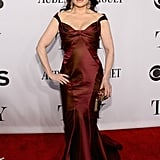 Idina Menzel wore a dark red frock.