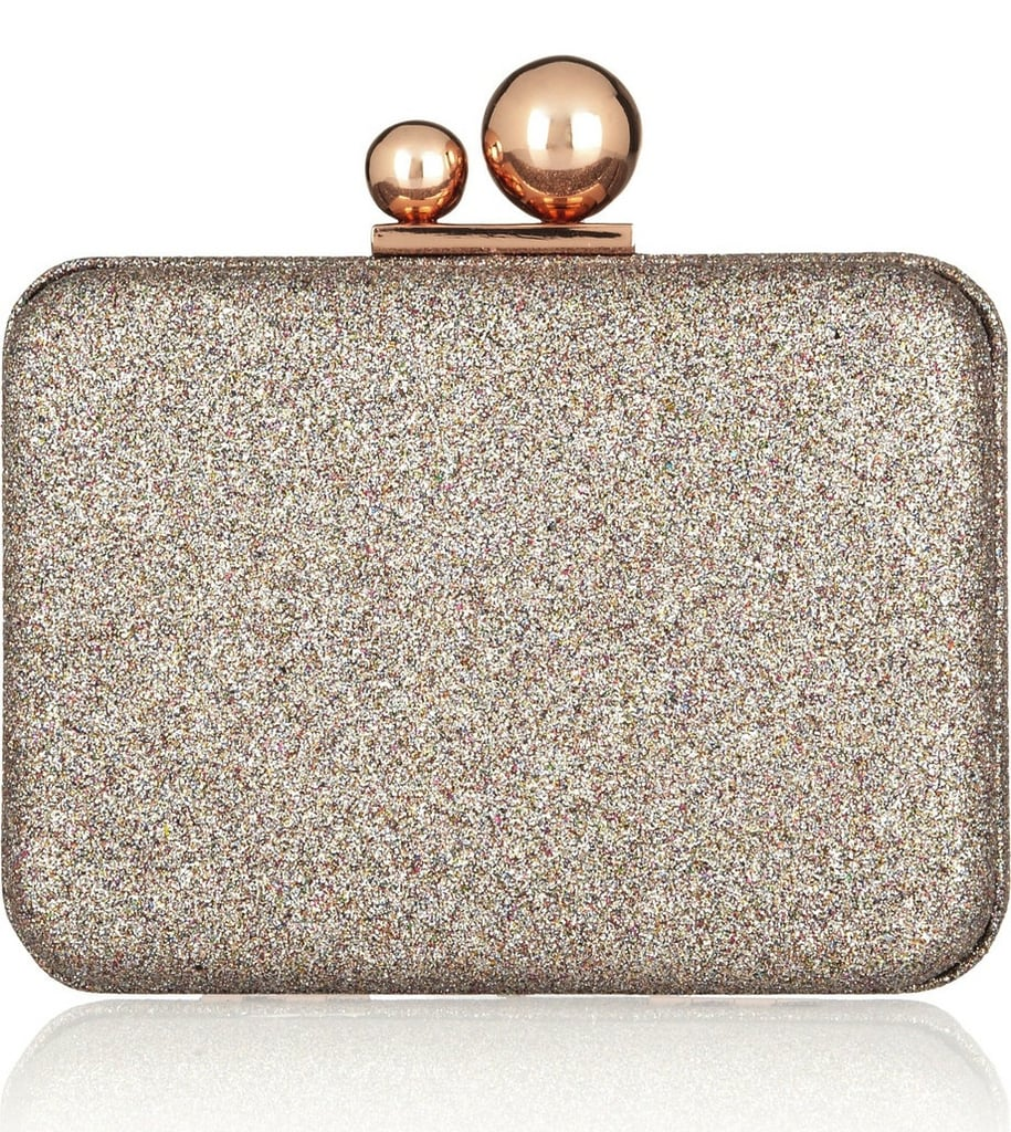 Sophia Webster's glitter clutch ($595) is majorly festive, and those two circle clasps set it apart from all the other glittery clutches out there.