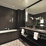 The sleek and dark bathrooms are ideal for relaxation time when you need to escape the busy city. The bath is so deep even the tallest people can easily stretch out and spend hours watching TV in the tub.
