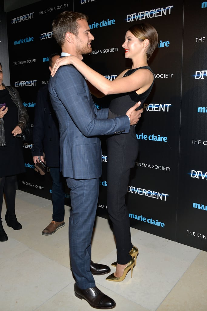 Shailene Woodley and Theo James were among the many stars at last night's screening of Divergent at NYC's Hearst Tower. Shailene wore a black sleeveless jumpsuit and gold heels for the big night, while Theo stepped out in a navy suit, and their co-star Ansel Elgort kept things casual in a varsity jacket. The group's buzzed-about film only hits Australian cinemas on April 10, but earlier this week, the cast chatted with POPSUGAR US at the LA premiere. During an interview with Shailene, the actress told us that she saw a lot of George Clooney in Theo, and Kate Winslet answered an important question: Theo or Leo? Keep reading for more pictures from the NYC premiere!