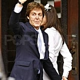 Paul McCartney and Nancy Shevell held hands.