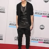 Justin Bieber wore red studded loafers.