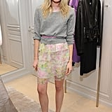 A grey sweater stops this ruffled skirt looking too girly on Dree Hemmingway.