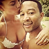 Chrissy Teigen planted a sweet smooch on her new husband, John Legend, during their honeymoon in Portofino, Italy. Source: Instagram user chrissyteigen